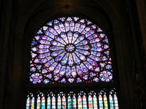 One of many impressive windows in Notre Dame.  No hunchbacks were injured in the taking of this photo.
